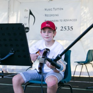 Do Re Mi Studios student Arthur playing at the Oyster Bay Arts and Crafts Festival