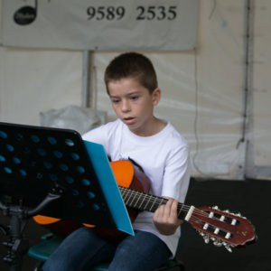 Do Re Mi Studios student Charles playing at the Oyster Bay Arts and Crafts Festival