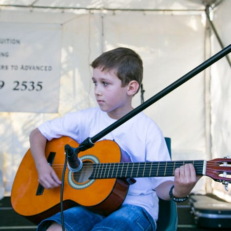 Do Re Mi Studios student David playing at the Oyster Bay Arts and Crafts Festival