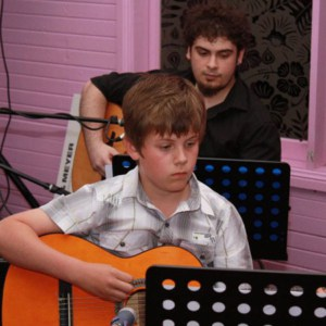 Guitar student Jack performing at the Do Re Mi Studios annual concert