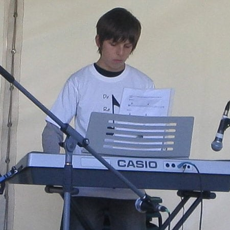 Do Re Mi Studios student Jacob playing at the Oyster Bay Arts and Crafts Festival