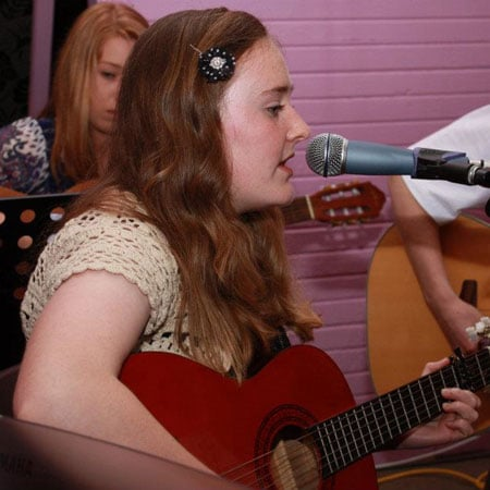Guitar and singing student Kate performing at the Do Re Mi Studios annual concert