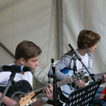 Do Re Mi Studios students Will and Max playing at the Oyster Bay Arts and Crafts Festival