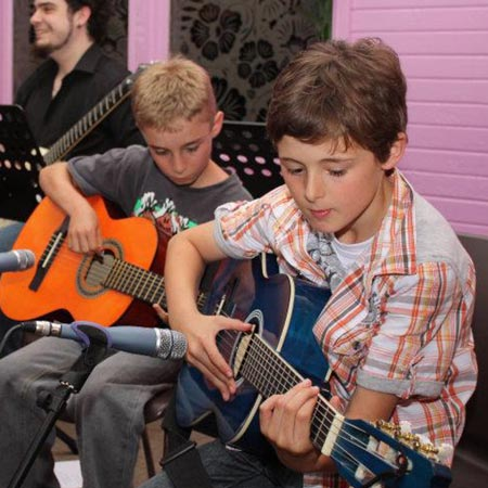 Guitar students performing at the Do Re Mi Studios annual concert