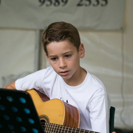Do Re Mi Studios guitar student Patrick performing at the Oyster Bay Arts and Crafts Festival