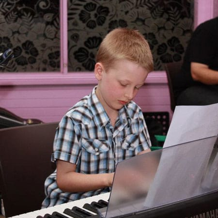 Piano student Sam playing at the Do Re Mi Studios annual concert
