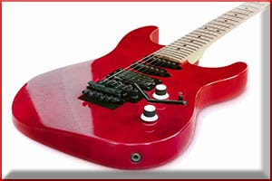Red electric guitar on a white background