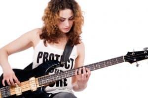 Girl playing bass guitar